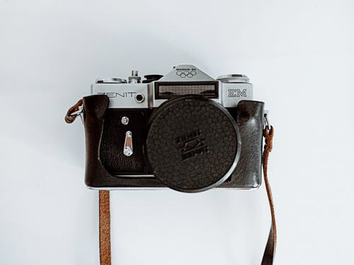 Old fashioned photo camera in leather case