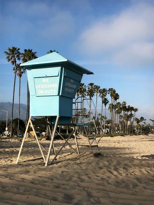 Blue Wooden Lifeguard House on Beach