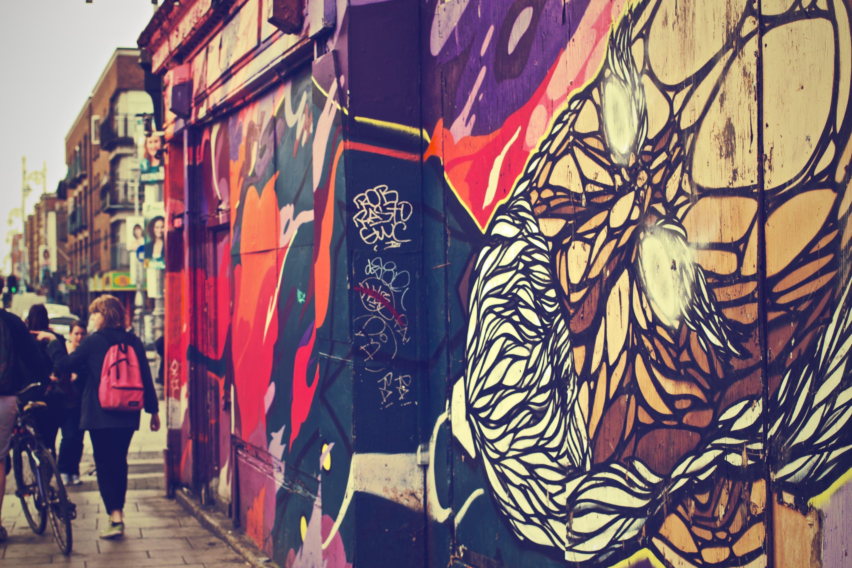 Walking Woman Beside Graffiti Art