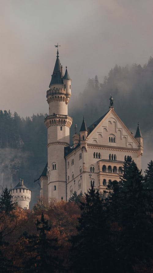 Old medieval castle with towers in forest