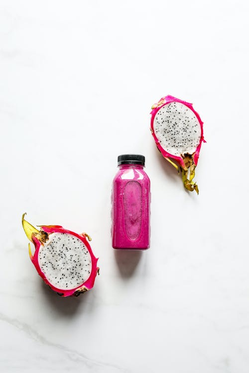 Purple Glass Bottle With White and Yellow Floral Cap