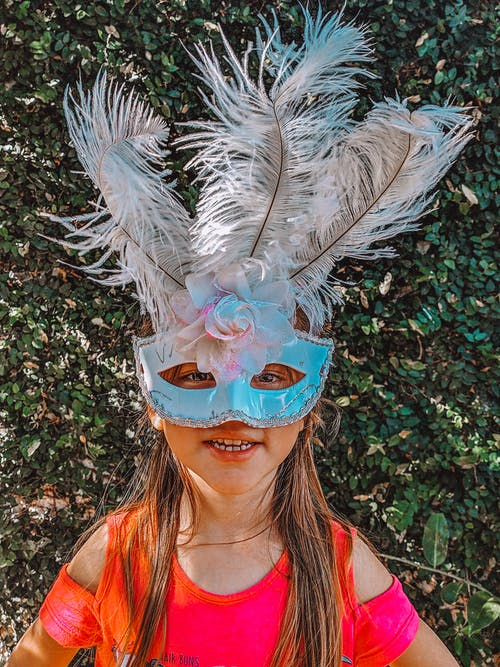 Free stock photo of bird feathers, carnival, girl