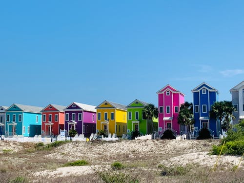 Bright multicolored beachfront houses on hilly terrain