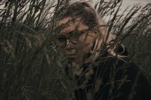 Woman in Grass Field