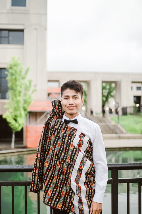 Stylish young ethnic man in trendy outfit
