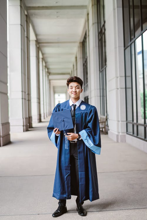 Man in Blue Academic Dress Smiling