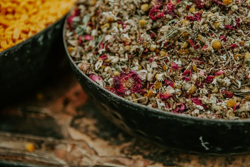 Bowl with dry flowers in market