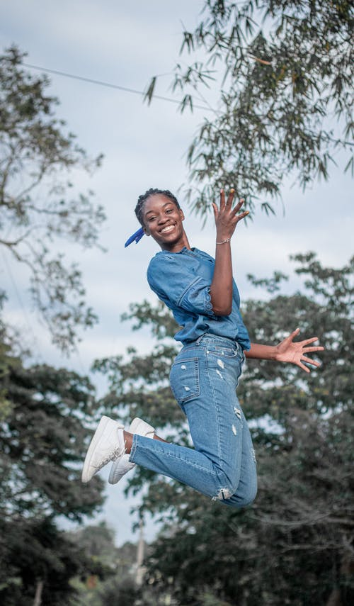 Photo of Person Smiling While Doing Jump Shot