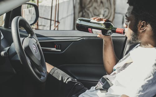 Photo of Man Drinking Red Wine