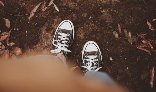 Person Wearing Converse Sneakers