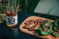 Photo of Grilled Meat on Wooden Plate