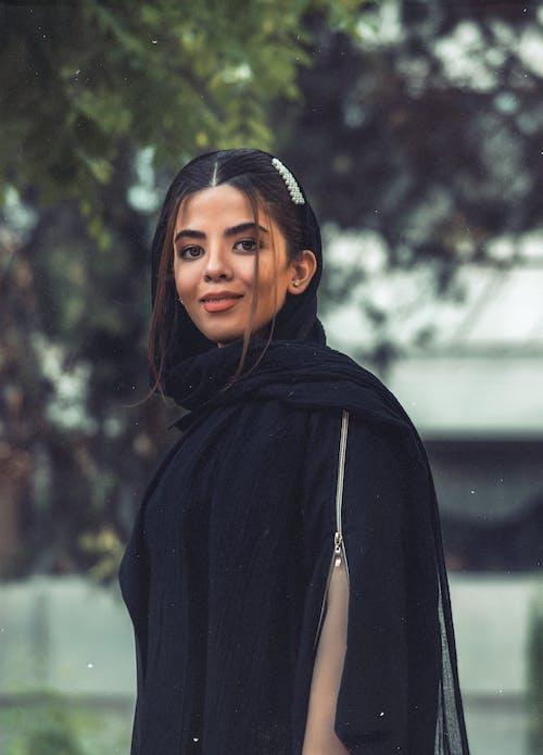 Woman Wearing Black Top Smiling