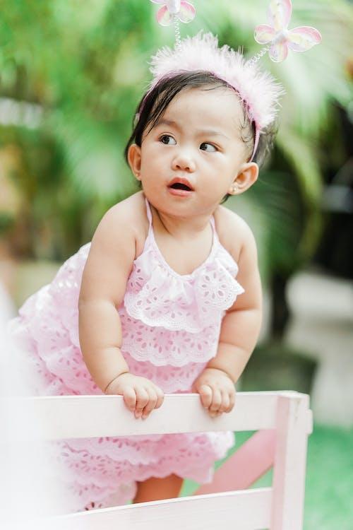 Girl Wearing Pink Dress and Pink Headband