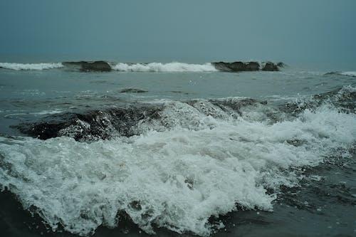 Small waves crashing near coast