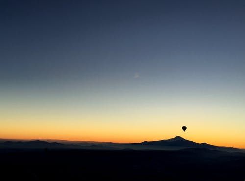 Silhouette of Mountain and Hot Air Balloon
