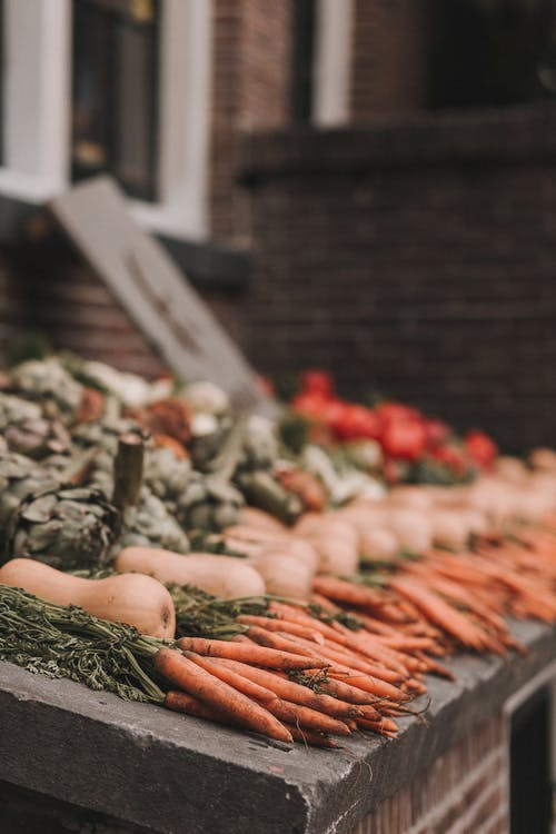 Photo of Carrots Displayed in Street Market