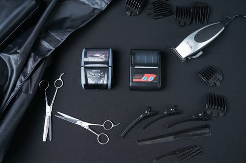 Cash registers among clipper and hairdressing tools