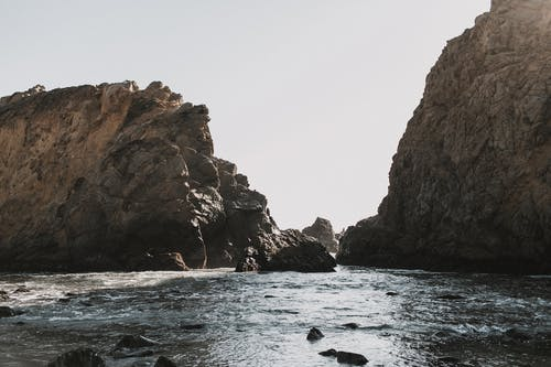 Brown Rock Formation on Seashore