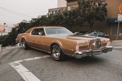 Brown Coupe Parked on Parking Lot