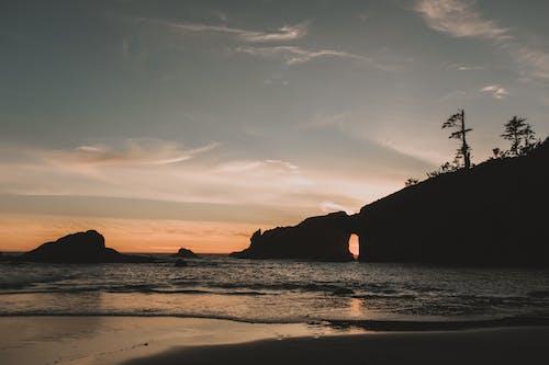 Photos gratuites de aube, bord de mer, cailloux, coucher de soleil