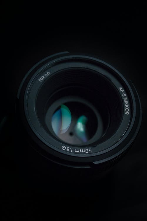Black Camera Lens on Black Surface