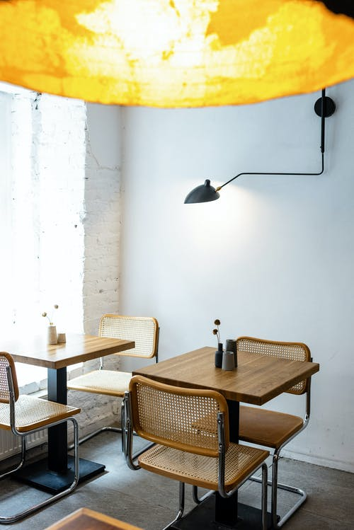 Interior of modern cafe with stylish yellow lamp