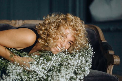 Photo of Woman With Curly Hair Smiling