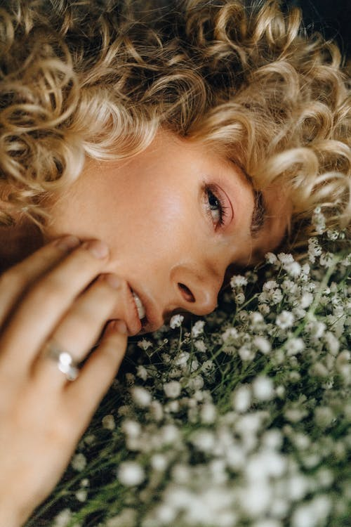 Photo of Woman's Face on White Flowers