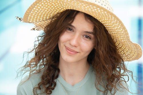 Woman in White Crew Neck Shirt Wearing Brown Straw Hat