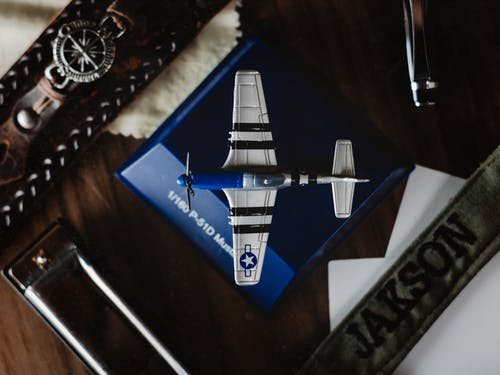 Toy airplane on support in room