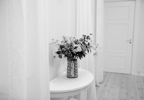 Bouquet of flowers on table in room