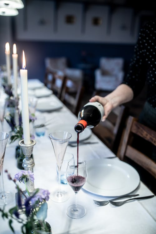 Anonymous person pouring wine in glass
