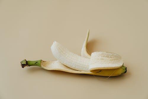 Yellow Banana Peel on White Surface