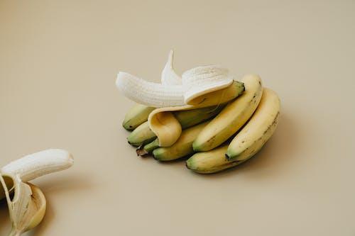 Green Banana Fruit on White Surface