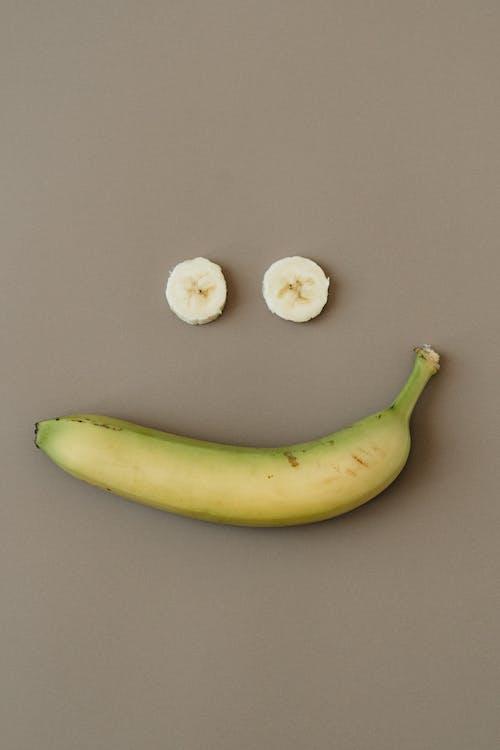 Yellow Banana Beside White Round Fruit