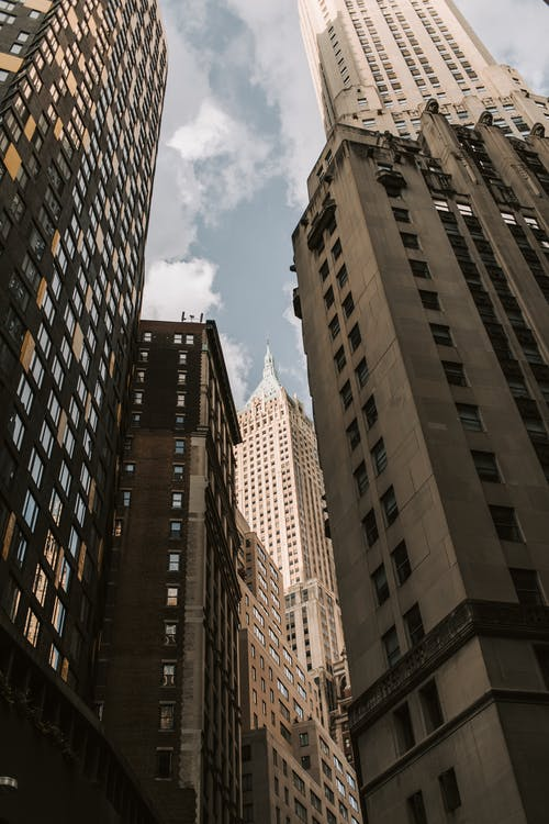 Brown and Black Concrete Building Under Blue Sky