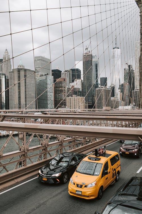 Yellow Taxi Cab on Bridge