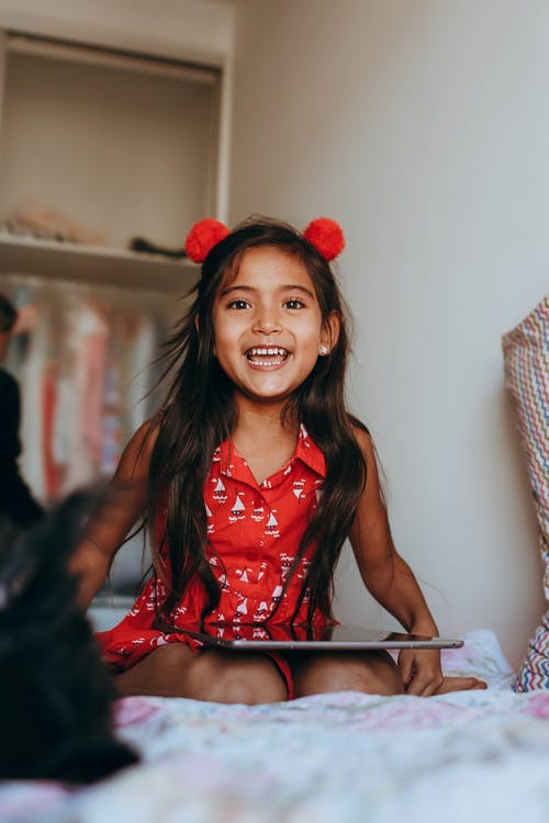 Smiling Little Girl in Red Dress