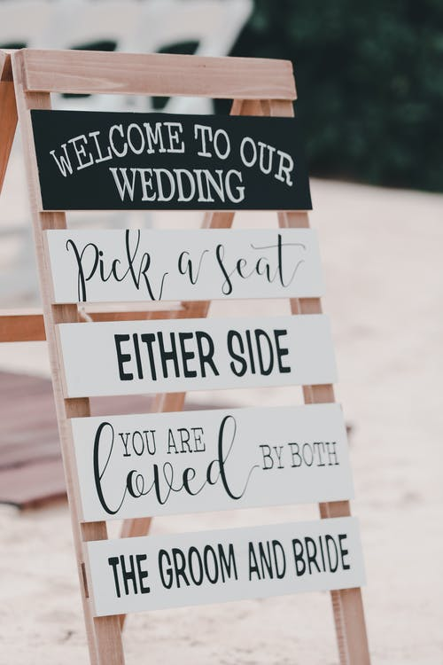 Signboard with inscriptions representing invitation to wedding