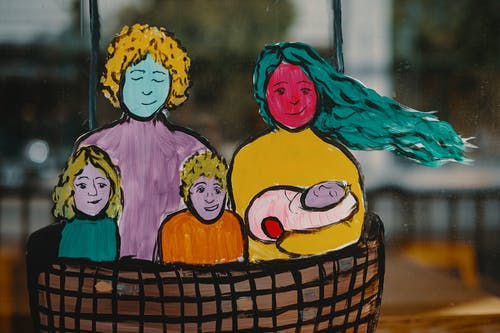 Colorful picture of family with baby in basket