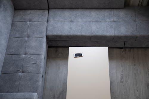 White Rectangular Device on Gray Concrete Wall
