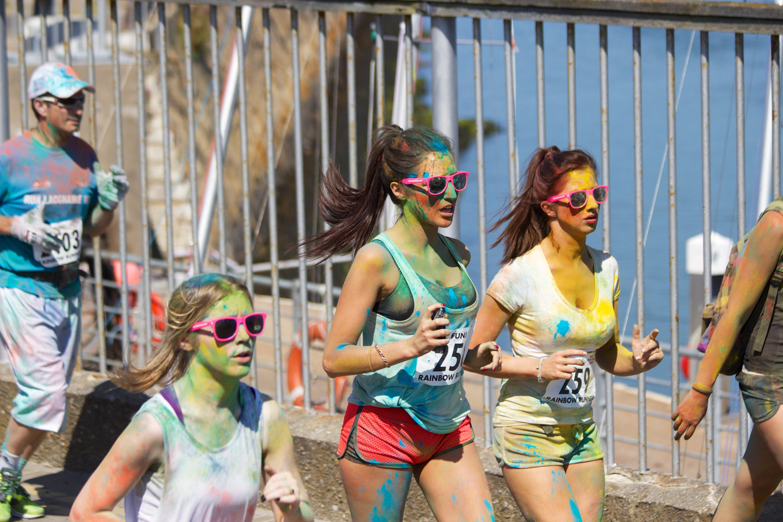 People Running With Paint Stains