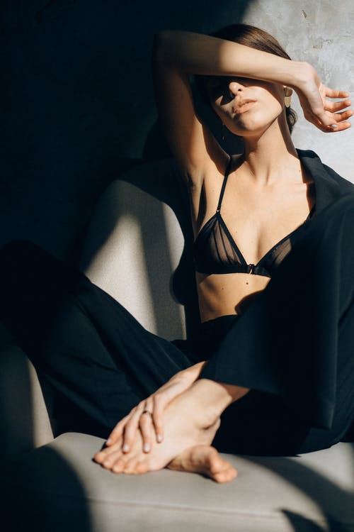 Woman in Black Brassiere and Black Pants