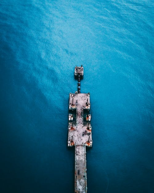 Aerial View of White Boat on Blue Sea