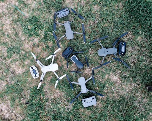 White and Black Power Devices on Green Grass