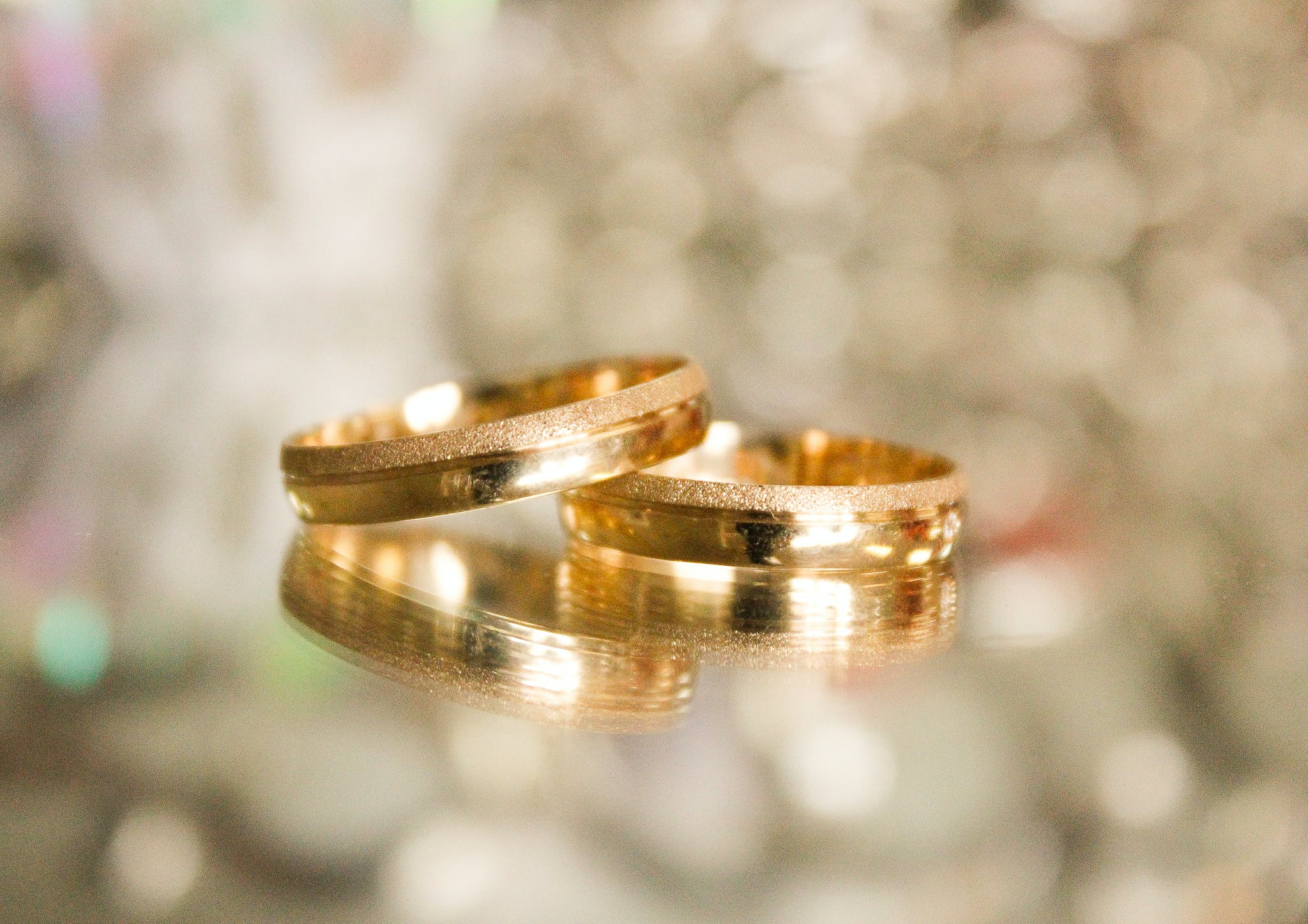 Two Gold-colored Rings in Selective Focus Photography
