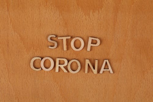Free stock photo of corona, stop, wooden background, wooden letters