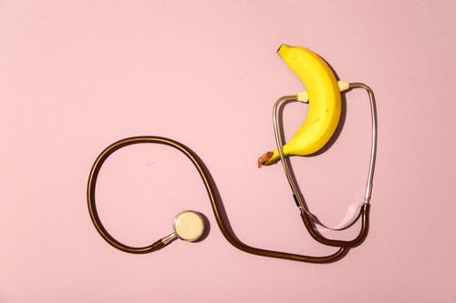 Yellow Banana and White Earbuds