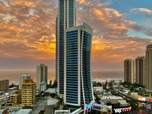 Coastal city with modern architecture at sunset