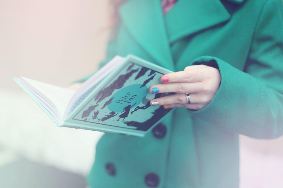Woman Holding Peter Pan Book